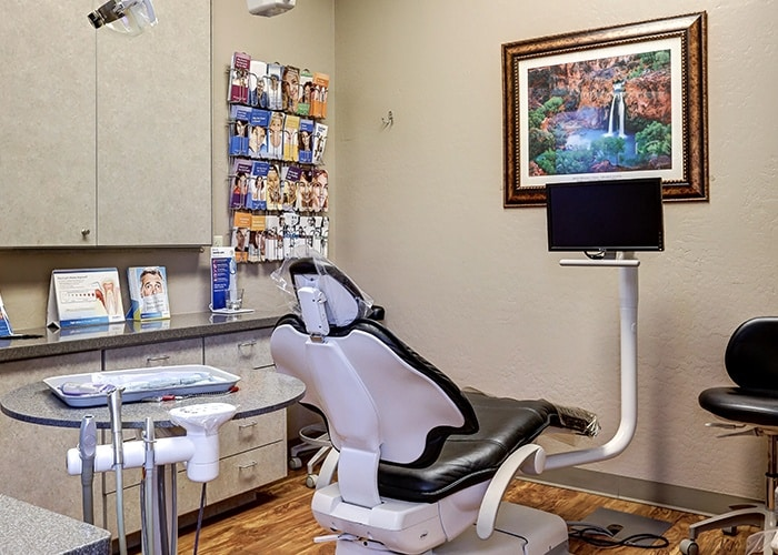 Backview of Dental Chair and Pamphlets on Wall