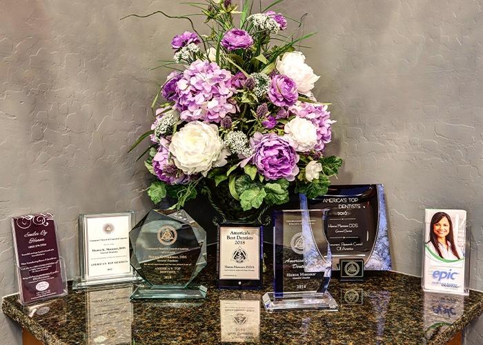 floral bouquet next to dental award plaques