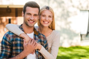 Beautiful young couple holding each other and smiling